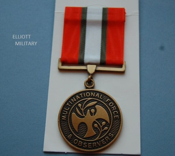 medal showing a dove and olive branch