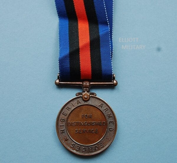 reverse of medal reading Nigeria Armed Forces for distinguished service