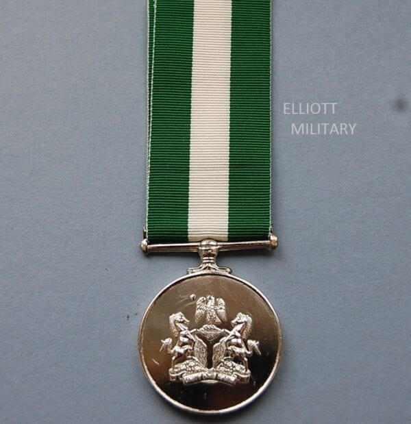 circular medal with Nigerian coat of arms and motto Unity And Faith