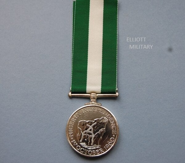 reverse of medal with map and independence date