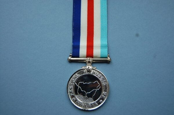 circular medal with map and inscription Federal Republic of Nigeria
