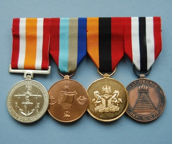 4 Nigerian medals on a mounting brooch
