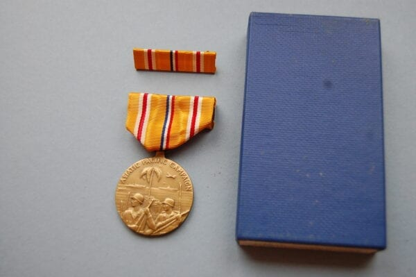 medal with box and ribbon brooch