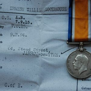 Obverse of medal with papers in background