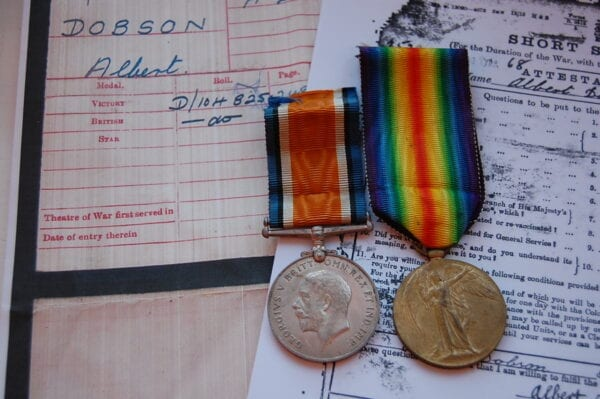 obverse of medals with papers