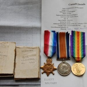 obverse of medals with papers and boxes