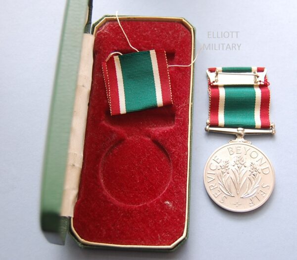 REVERSE OF MEDAL AND BOX INTERIOR